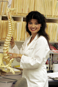 Dr. Shaw with a model of a spinal cord